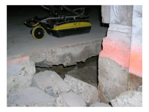 A visual inspection of the void underneath the slab as determined with the GPR scanning.
